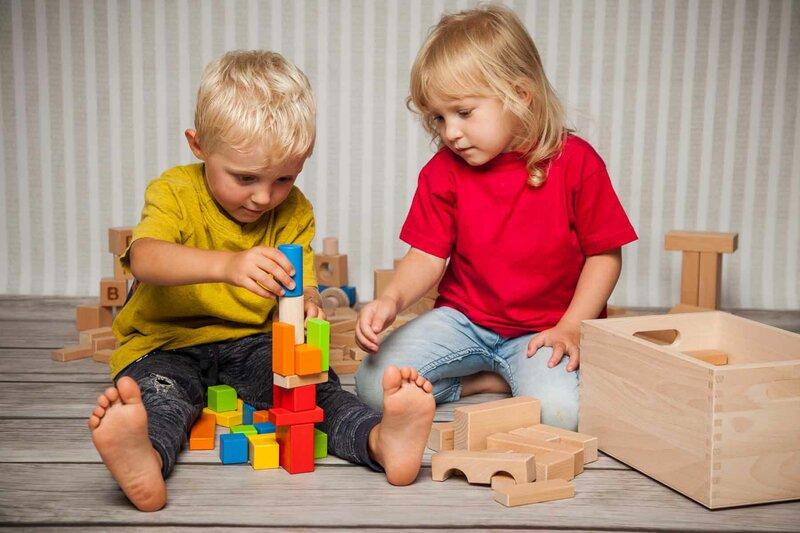 Sets of wooden building blocks